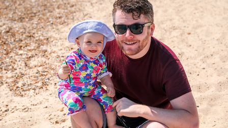 One year old Mabel Clark with dad Stuart enjoying the sun on Felixstowe Beach Picture: STEPHEN WAL