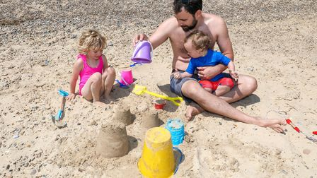 Alex Montali from London, building sand castles in Southwold with children Florence, 4, and Alfred,