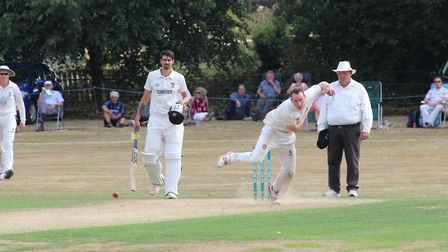Ollie Bowling bowling on his Unicorns Championship debut for Suffolk against Norfolk at Copdock Phot