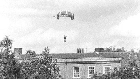 A parachutist descends on Glemham Hall in 1971 Picture: OWEN HINES
