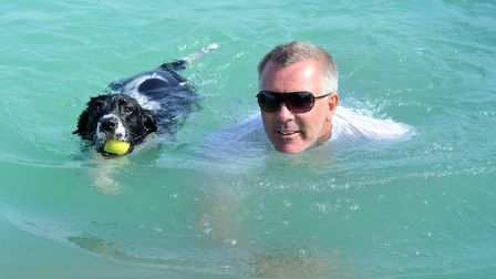 Andy Brownlie and his dog Buddy have a swim Picture: SARAH LUCY BROWN