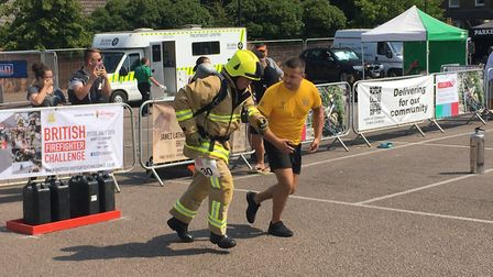 Firefighters from around the world endured brutal heat on the first day of the British Firefighter C