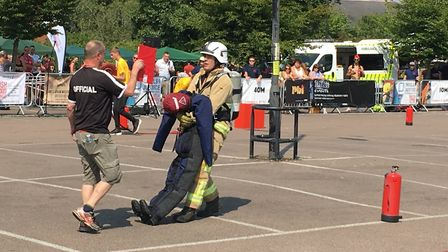 A firefighter drags a dummy in the Arc shopping centre car park Picture: MICHAEL STEWARD