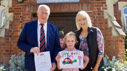 Poster competition winner Hope Singleton outside St George's Primary School in Great Bromley, with C