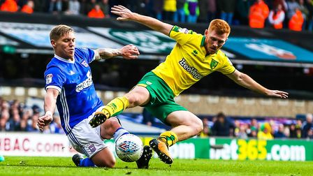Martyn Waghorn and Harrison Reed battle for the ball in last season's East Anglian derby at Portman