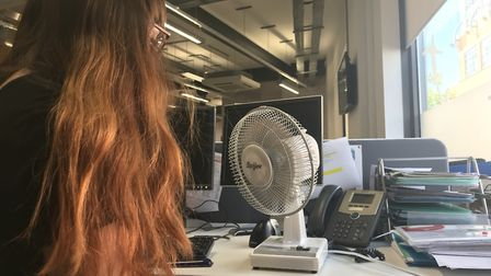Megan Aldous at the Archant office in Ipswich with a desk fan