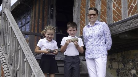 Aldeburgh Museum curator Catherine Howard-Dobson with local children vy and Archie Hill and their f