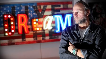 Chris's neon artwork has been sought after by celebrities Picture: GREGG BROWN