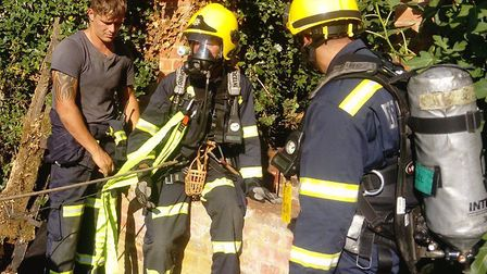 Suffolk firefighters rescued a dog from a well Picture: SUFFOLK FIRE AND RESCUE SERVICE