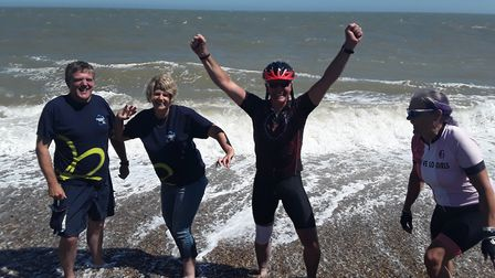 Peter Berry and his supporters arrive in Aldeburgh to complete the Dementia Cycle Challenge Picture: