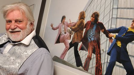 Former Sunday Times snapper Tom Murray with his image of The Beatles which will be made into a bronz