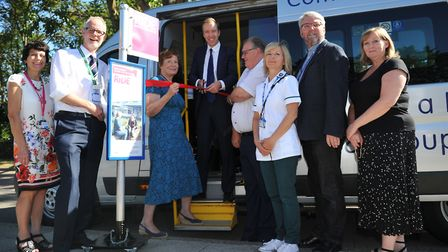 MP Matthew Hancock, secretary of state for health and social care, cuts the ribbon as the new bus se