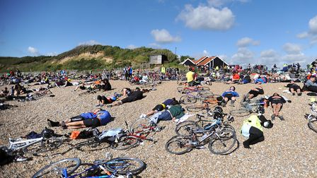 Cyclists resting on the beach after a completing a previous Dunwich Dynamo ride Picture: GREGG BROWN