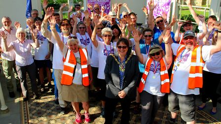 Participants celebrate the end of this year's Challenge Walk at the Orangie in Holywells Park with I