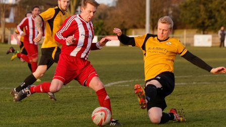 Danny Bloomfield, in action for one of his former clubs Felixstowe & Walton three years ago, will ad