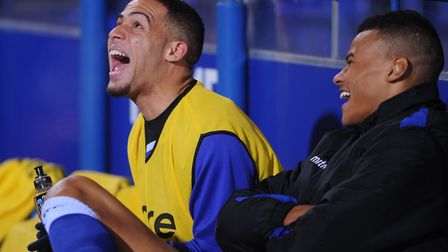 Jordan Graham shares a joke with Tyrone Mings during his time at Ipswich in 2013. Photo: Gregg Brown
