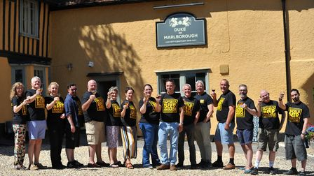The fifteen expert judges raise a toast to their efforts outside the 16th century pub Picture: SARAH
