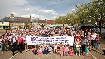 People in Wickham Market gathered to launch a share scheme to save The George pub Picture: JULIAN EV