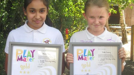Laureate Community Academy sports leaders Alesha Baig and Heather Sweeney with their Gold PlayMaker