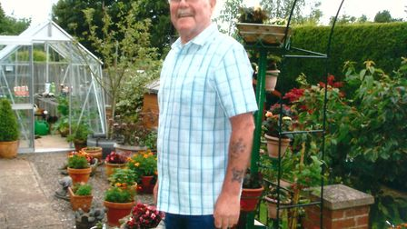David Warnes in his garden at home. Picture: YVONNE GRIMES