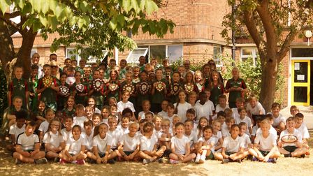 All of Sidegate Primary's team members with their numerous trophies, as the school celebrates its mo