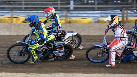 Cameron Heeps (blue) and Rory Schlein lead Mikkel B Andersen in the opening heat against Redcar rece