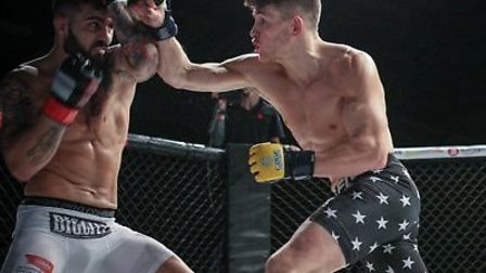 Steve Aimable, right, in action. He's signed a multi-fight deal with Cage Warriors. Picture: SABS SH