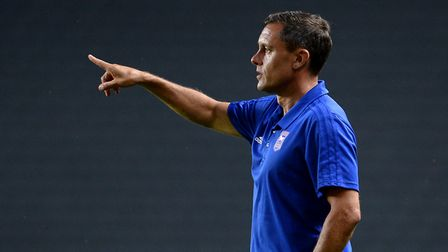 Paul Hurst gives some directions to his players at MK Dons. Photo: Pagepix