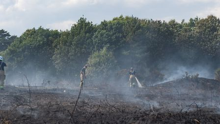 Fire fighters on scene damping down the fire that had spread into the National Trust Pin Mill Planta