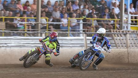 Nico Covatti goes round Adam Ellis in heat three at Foxhall on Thursday. Picture: Steve Waller