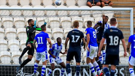 Dillion Barnes keeps his eye on the ball during the pre-season fixture against Millwall. Picture: ST