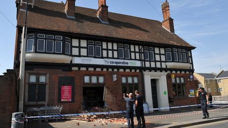 Police investigate the scene of a ram raid that took place overnight on the Co-op in Halstead Pictu
