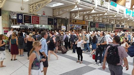Passengers trying to board a train from Liverpool Street to Norwich after a trackside fire and hot w