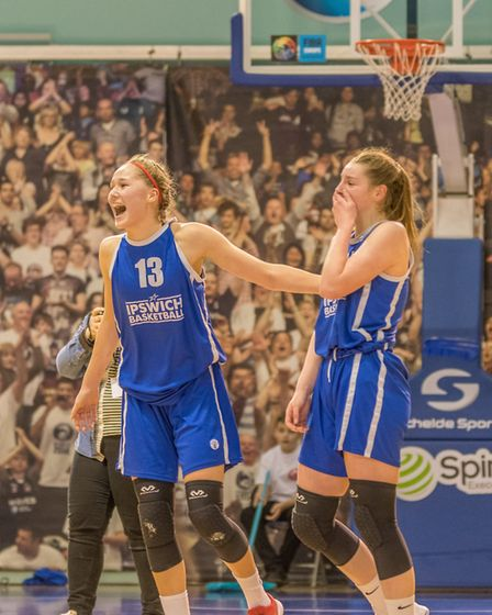 Esther Little, left, celebrates leading her Under 16 Ipswich side to the national title. Picture: PA