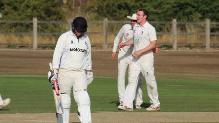 Suffolk bowler Ollie Bocking, right, is congratulated on taking a wicket during the innings victory