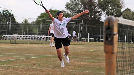 Asa Sumner-Keens stretches for a volley during his defeat to Ryan Lambert at Framlingham. Picture: J