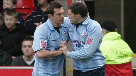 Paul Hayes, left, is congratulated by team-mate Gary Hooper after scoring for former club Scunthorpe