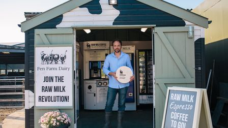 Jonny Crickmore holding his Baron Bigod brie cheese at Fen Farm Dairy, Bungay Picture: KAT MAGER PHO