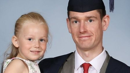 Michael Heathcote with his daughter during the special graduation ceremony Picture: EDE AND RAVENSCR