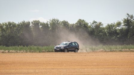 A driver taking a shortcut across a field in an attempt to avoid an 11 mile diversion in Lakenheath,