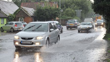 Flash floods caused by heavy rain and thunder on roads in Ipswich Picture: SARAH LUCY BROWN