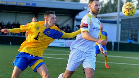 Jordan Blackwell, left, fending off Lowestoft's Ryan Jarvis, is back playing for AFC Sudbury this se