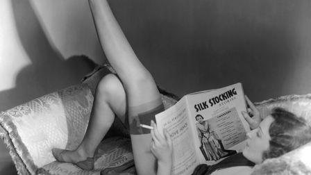 UNITED STATES - CIRCA 1950s: Woman reading magazine. Picture: Getty Images/George Marks