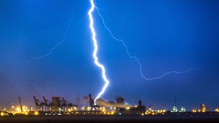"""Lightning flashes over Humber estuary near Hull as clouds obscure a view of the """"Blood moon"""", the lo"""