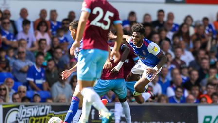 Ellis Harrison is felled by Cheikhou Kouyate in the first half of the Ipswich Town v West Ham (Pre-s