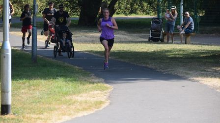 Megan Evans on her way to first place, pursued by two buggies. Your columnist is thankfully obscured