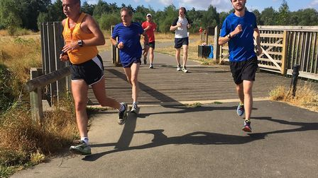 Runners near the finish of the seventh staging of the Pocket parkrun, held in bright conditions. Pic