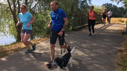 Runners in the shade make their way along the Pocket parkrun route, close to the River Great Ouse. P