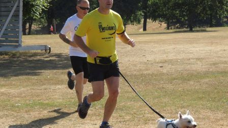 Dogs as well as runners and walkers enjoy the beautiful weather over a 5K parkrun course. Picture: I