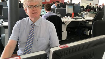 Paul Geater back at his desk after his operation. Picture: ADAM HOWLETT